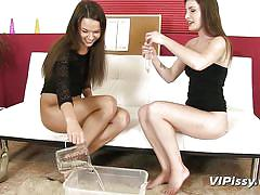 Sluts play with a piss filled condom
