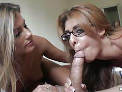 Two chicks suck the same cock