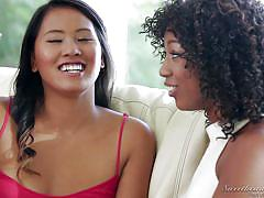 Asian and ebony lesbian share an erotic moment