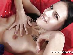 Raven haired babe mia loves to drench herself in warm golden pee