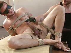 Blindfolded, tied and jerked