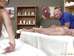 Horny masseur takes care of two babes
