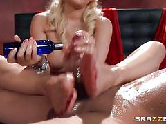 Busty blonde massages a cock with her feet