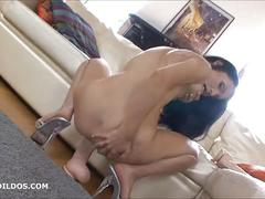 Raven haired russian riding a big brutal dildo