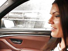 Beautiful babe sucks cock in car