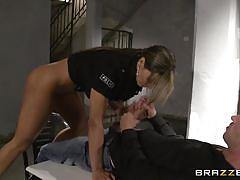 Big breasted cop interrogates the prisoner