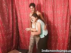 Busty indian girl spanks a guy's ass cheeks