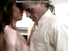 Amber woods, tom byron, marc wallice in vintage porn video