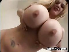 Dirty milf with very large fake tits