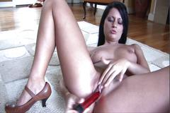 Stroking her wet cunt with a hot sex toy
