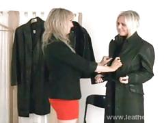 British ladies trying on leather coats