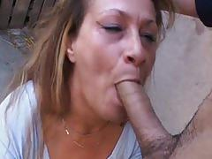 Horny young guy seduces mature woman for some barn yard fuck