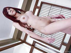 Redhead asian shemale shows off her ass