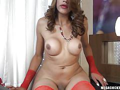 Hot busty tranny plays with her cock