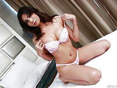 Busty shemale stretches her ass hole