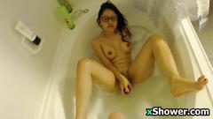 Nerdy girl masturbates in the bath tub