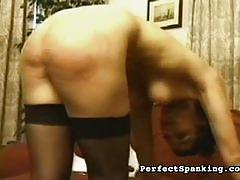 Blonde slave spanked with a rod