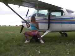 Horny blonde teen dildo's her meaty pussy by a plane