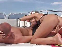 Horny brunette gives a blowjob on a yacht