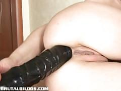 Blonde school girl bruising her asshole with a brutal dildo