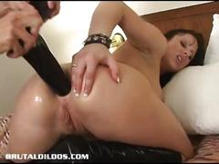 Moxxie uses big black dildos to fill both her holes