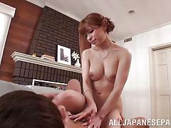 Busty asian rides a guy on the sofa