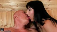 Young girl seducing very old grandpa