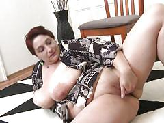 Horny bbw lady playing with her huge titties