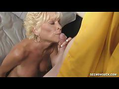 Mature blonde slut gives a young stud a blowjob