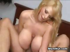 Blonde milf with large fake breasts