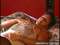 Granny karen caresses her body in bed