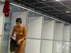 Tanned babe in  the shower
