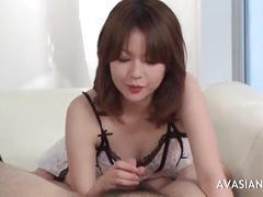 Hot asian girl givers a lovely handjob for cum
