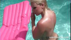 Blonde tanning in the pool fucks herself with a sex toy