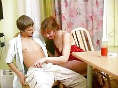 Russian beauty fucks young boy