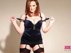 Jodie gasson poses in her tight blue dress