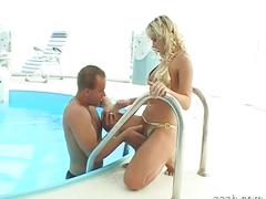 Busty blonde babe loves pool sex with her lover.
