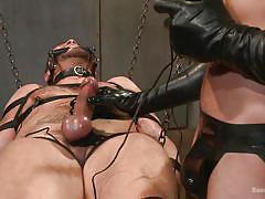 Gagged guy endures bdsm teasing and torture