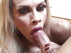 Busty blonde ladyboy enjoys cock sucking action