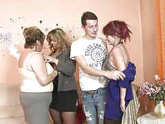 Guy entertained by three mature ladies