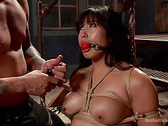 Busty asian enjoys giving blow jobs while tied