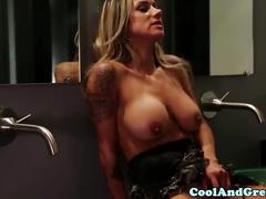 Busty lesbian strapon fucked in restroom