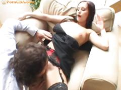 Sexy brunette busty babe sucks on hard cock.