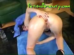 Lubed up chick fists her pussy and ass