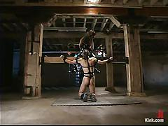 White male slave is locked in a dungeon and whipped