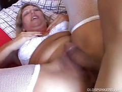 Sexy mature babe xena looks very fuckable in white suspenders