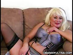 Busty blonde mature sucks a hard rod of black meat