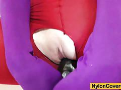 Zena covers her body in nylons and rides a dildo