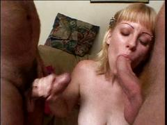Sexy young blonde swallows cum after sucking off two guys on her knees