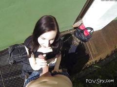 Hungry chick kneels down and sucks big hard cock